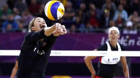 Kerri Walsh Jennings, left, returns the ball as