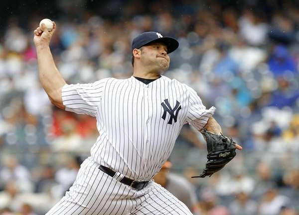Joba Chamberlain pitches during the seventh inning of
