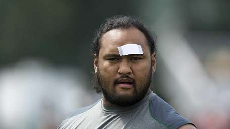 Sione Pouha did not practice because of an