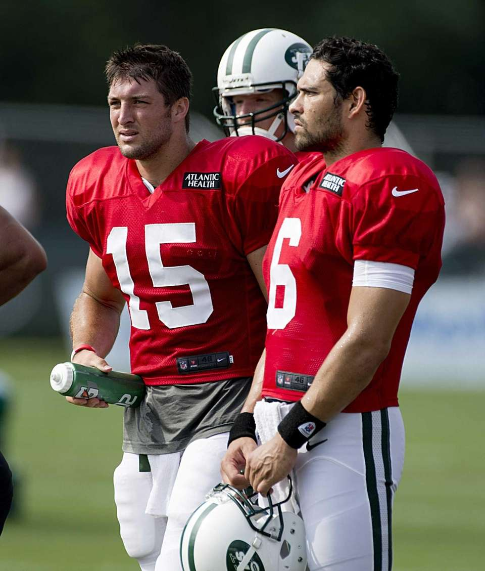 Tim Tebow, left,Greg McElroy and Mark Sanchez, right,