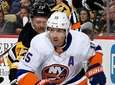 Cal Clutterbuck of the Islanders handles the puck