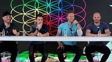 Coldplay band members Jonny Buckland, left, Guy Berryman,