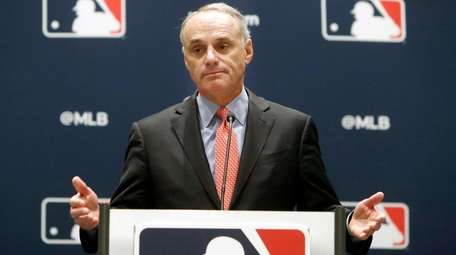 Baseball commissioner Rob Manfred speaks to the media