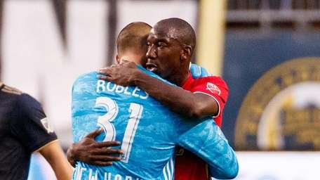 The Red Bulls' Bradley Wright-Phillips, right, gives Luis