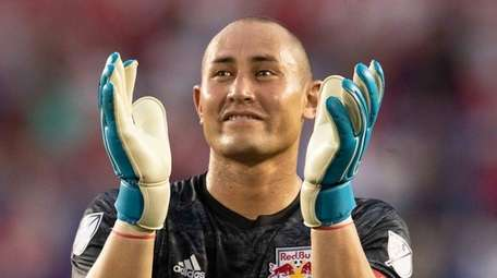 Red Bulls goalkeeper Luis Robles applauds fans at