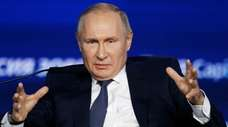 Russian President Vladimir Putin speaks during an annual