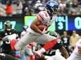 Giants running back Saquon Barkley leaps with the