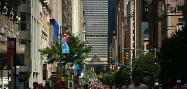 Pedestrians and bicyclists participate in NYC's Summer Streets.