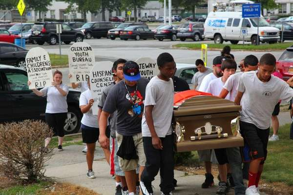 Carrying coffins toward the Nassau County Administration building,