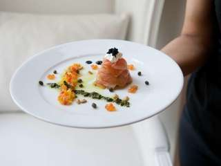A sushi-style, dill-marinated salmon with champagne-flavored cream cheese