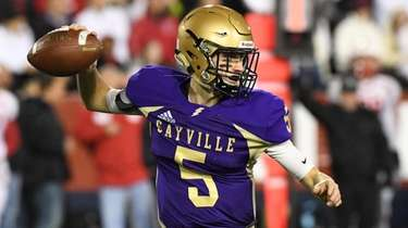 Sayville quarterback Jack Cheshire passes the football against