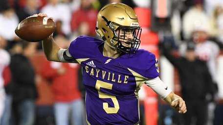 Sayville quarterback Jack Cheshire passes the football against
