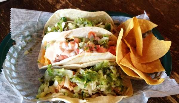 A taco trio -- shredded chicken, fried fish