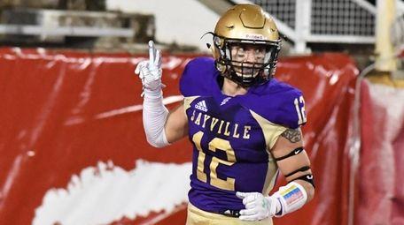 Sayville's Brock Murtha reacts after he intercepts a