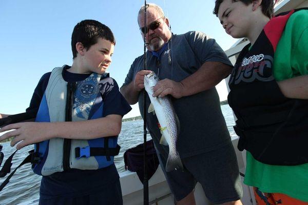 Kevin Bradbury and his sons, Joe, 13 (left),