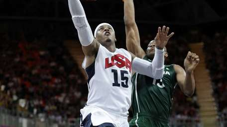 Team USA's Carmelo Anthony (15) drives to the