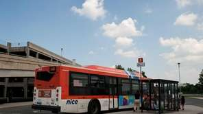 Passengers board the n16 NICE bus at the