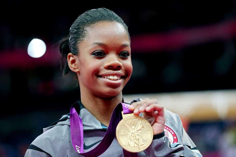 Gabrielle Douglas of the United States celebrates on