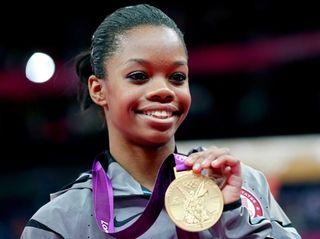 Gabrielle Douglas of the United States celebrates on