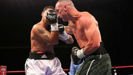 Sean Monaghan fights against George Armenta at the