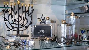 A display of Michael Aram gift items includes