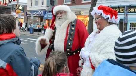 Santa Claus and Mrs. Claus greet a group