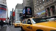 Taxi cabs line up on 7th Avenue near