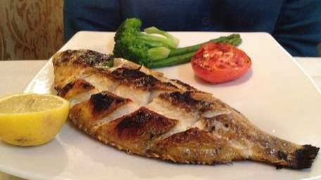 Whole red tilapia served at Turquoise restaurant in