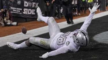 Josh Jacobs of the Oakland Raiders celebrates after