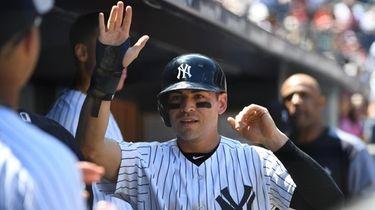 Yankees centerfielder Jacoby Ellsbury is greeted in the
