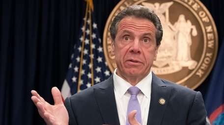 Gov. Andrew Cuomo responds to reporters questions at