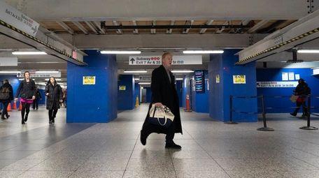 LIRR passengers walk in the railroad's concourse in