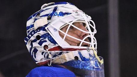 Rangers goaltender Henrik Lundqvist looks on against the
