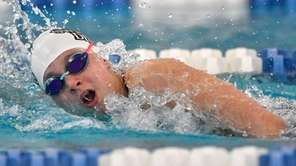 Herricks' Sophia Karras swims in a preliminary heat