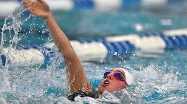Miller Place's Angelina Harris swims in a preliminary