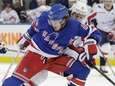 Rangers' Brendan Lemieux protects the puck from Washington