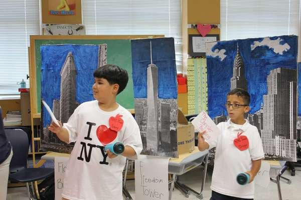 Fourth-graders Samy, left, and Diego give tours of