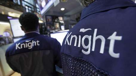 Knight Capital specialists work at their posts on
