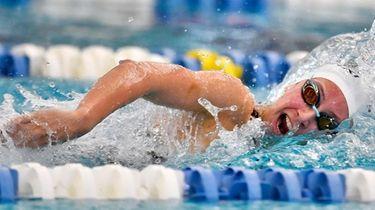 Northport-Commack's Chloe Stepanek swims in a preliminary heat