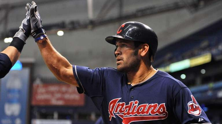 Outfielder Johnny Damon of the Cleveland Indians scores