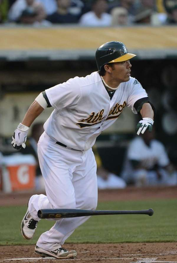 Kurt Suzuki of the Oakland Athletics watches the