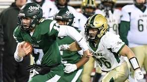 William Floyd quarterback Thomas Verga runs ahead of
