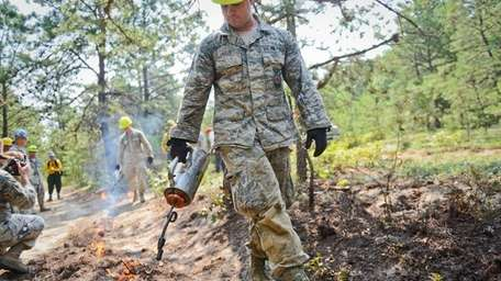 Sgt. Ed Kelly, of Farmingville, uses a drip