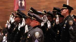 Police officers take their oaths of office after