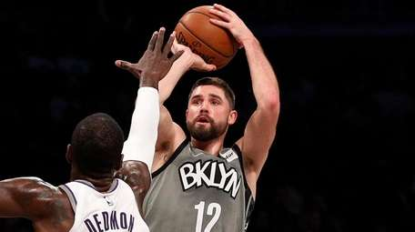 Joe Harris of the Nets attempts a three