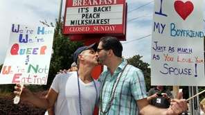 Jim Fortier, left, and Mark Toomajian, kiss as
