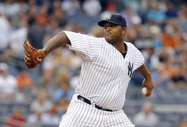 CC Sabathia pitches against the Seattle Mariners at