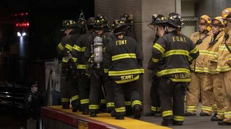 Firefighters respond to a train derailment at the