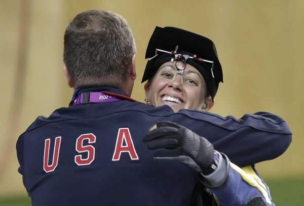 USA's Jamie Lynn Gray is hugged by her
