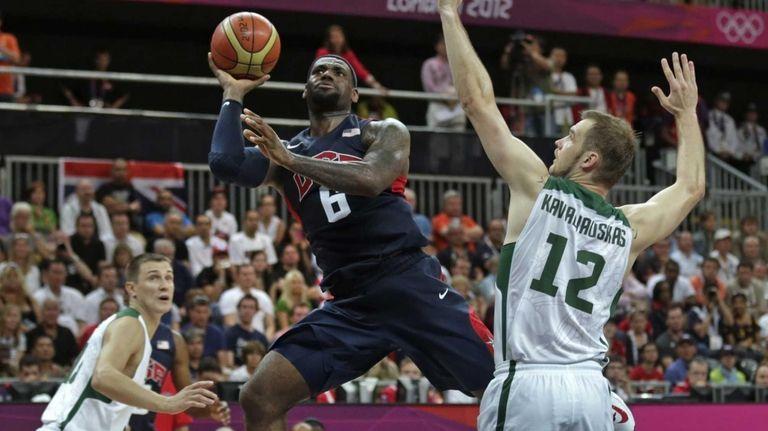 LeBron James shoots as he drives past Lithuania's